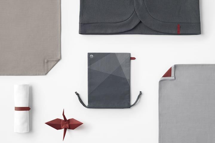 赤い「折り鶴」をモチーフにした JALの機内アメニティ用品の新デザイン